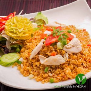 Chilli paste fried rice with onions, carrots, tomatoes, spring onions, green peas & eggs