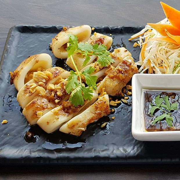 thai style grilled Calamari with fried garlic, served with Thai gravy and more garlic