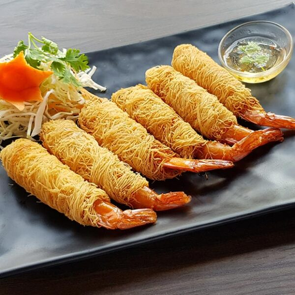 Crispy noodle-wrapped prawns served with plum sauce