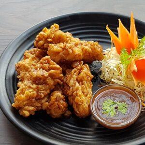 Crispy fried calamari served with Tuk Tuk special sour & sweet tamarind sauce